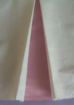 Comment faire un pli bicolore (peut être fort utile pour agrandir un vêtement trop serré!).