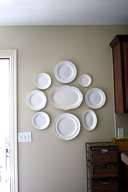 Plate wall...if you have a collection of unused mismatched plates u can spray paint them all glossy white or milk paint! So chic! :)