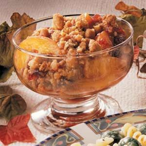 Cranberry Peach Crisp Recipe -Have a taste for a fruit crisp but don't have time to make it from scratch? This clever recipe simply combines canned peaches and cranberry sauce with a cookie crumb topping for a sweet crunchy treat.