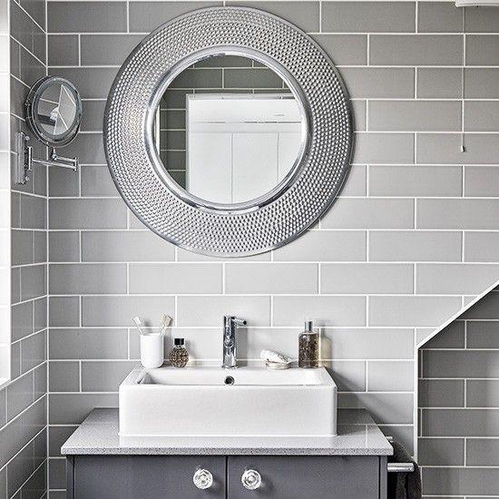 Modern grey bathroom with round mirrors
