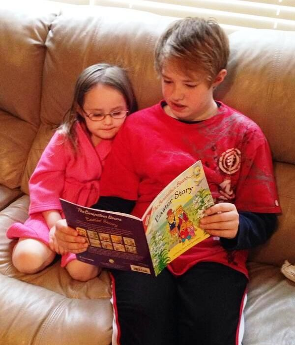 Brother reading The Berenstain Bears and the Easter Story to Sister ... :D