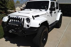White Jeep Wrangler Rubicon Unlimited 2014 with AEV Lift Kit, AEV Bullbar and AEV Head Reduction Bonnet.