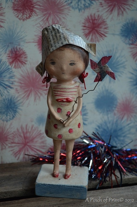 4th of July Paper clay art doll She could be holding a tiny flag.