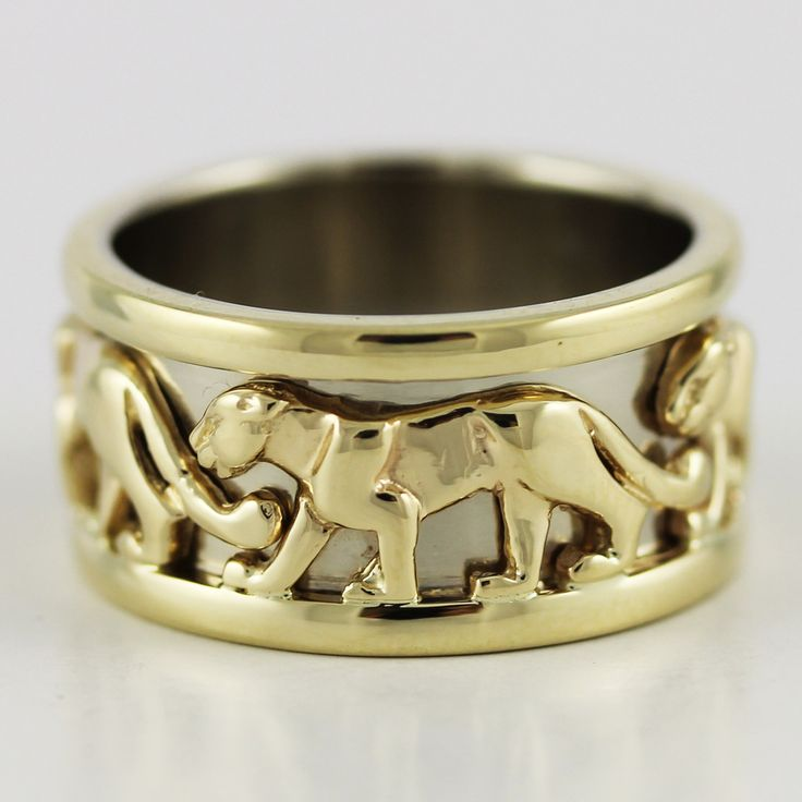 One expertly crafted 14k yellow gold panther ring.