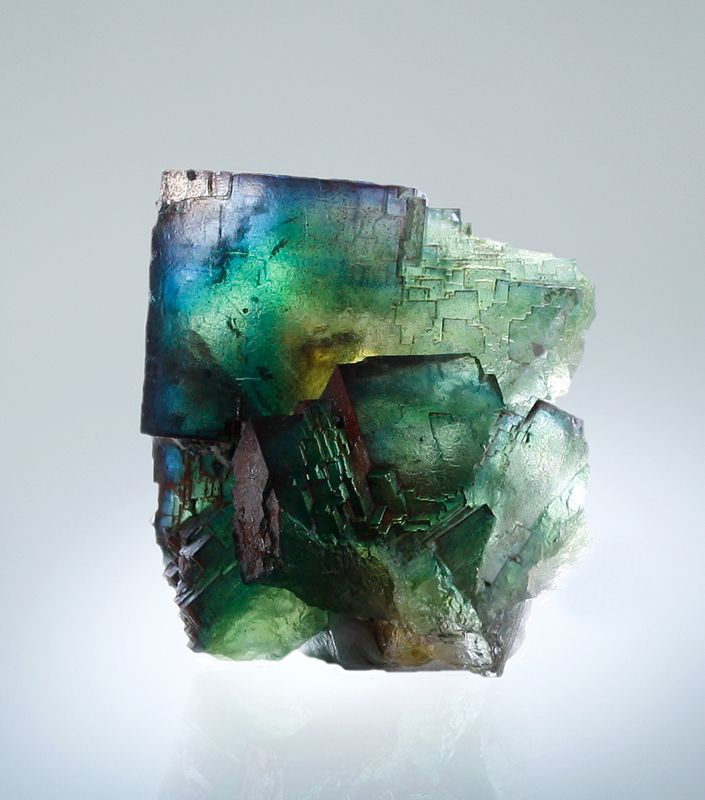 "Fluorite  Photo Copyright © Martin Gruell  - This image is copyrighted. .  Locality: Frohnau, Annaberg-Buchholz, Annaberg District, Erzgebirge, Saxony, Germany  8 x 5,5 x 4cm. With a little backlit you can see blue, green, lavender and yellow zones. A so called ""rainbow-fluorite"".  Material and foto Martin Gruell."