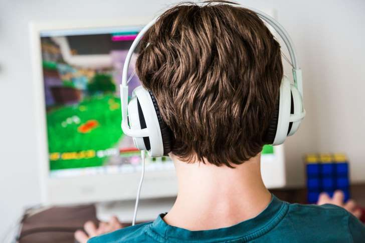 Teenager playing Minecraft multiplayer online game