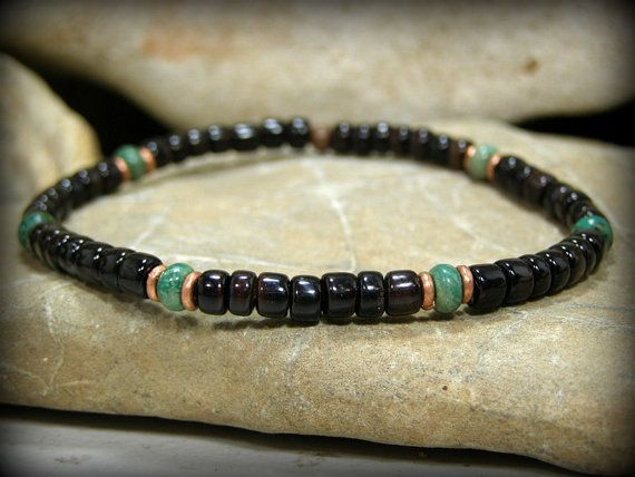 A nice mens bracelet beaded with cut and polished dark pen shell heishi and turquoise rondelle stones. Each rondelle has copper heishi surrounding it.  A cool tribal style pattern that can be worn for casual wear or even dress.  Length: 8 I can make this bracelet in a different size if needed. You can add a message in the note to seller at checkout or contact me through this listing with any questions.  Look for more designs in my shop here: stoneweardesigns.etsy.com