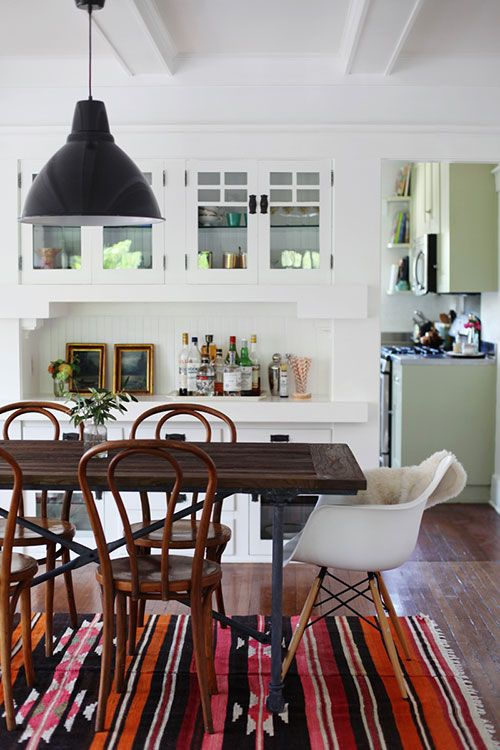 "Sneak Peek: Jessie Webster. ""I found this set of antique bentwood chairs on eBay. They are from the Mayo Civic Auditorium and date back to the '40s. I like to imagine all the music they've heard and all the people who've sat in them. The dining table is from Restoration Hardware and was on my wish list for quite sometime. As soon as it went on sale, I snatched it up. The pendant is from Ikea and the antique kilim rug gives my house a needed pop of color amongst the many muted tones.""…"