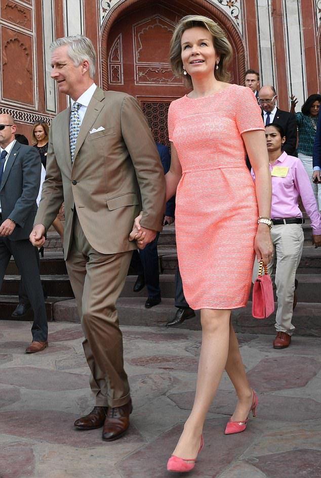 Belgium's King Philippe and Queen Mathilde, who is pretty in pink, step out holding hands on their way to the Taj Mahal in Agra
