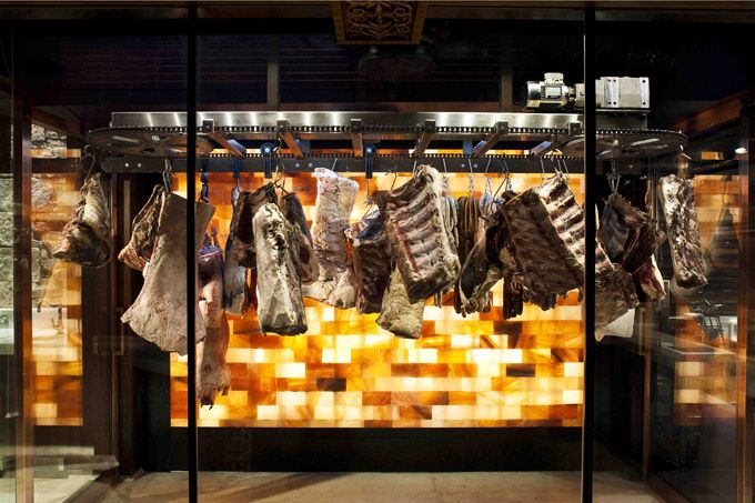 Sydney, Australia. Didn't think you'd ever end up window shopping for beef tenderloin?   The store boasts so many unique, custom-designed and exclusive features that the only way to absorb it all is a real-life visit. The features provoke, intrigue and amuse the customer – starting with the façade with its double-glazed, refrigerated vitrine for viewing the ever-changing array of hanging meat and poultry, plus selections displayed on custom-made copper and glass shelving.
