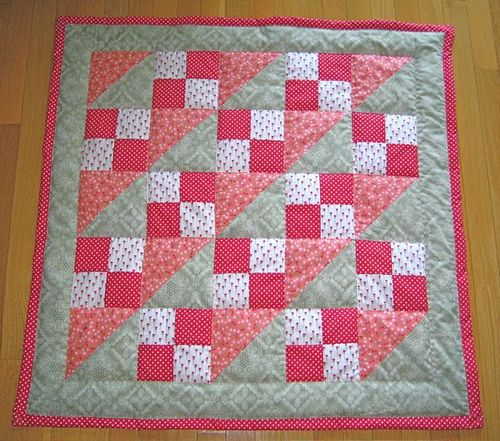 I like this pattern for Zoey's baby quilt. Colors will be hot pink, light pink and lime green.