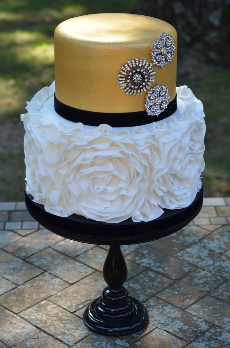 Fashion inspired cake. - Fondant rosette ruffle cake with gold metallic and brooches. https://www.facebook.com/ButADreamCustomCakes
