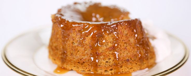 A super moist date cake is drizzled with warm toffee sauce that's been spiked with rum.