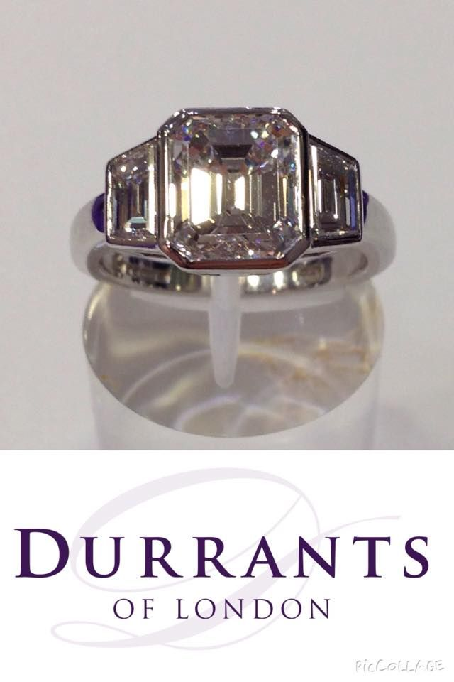 Timeless classic - Three stone diamond ring set with a 2.55ct E VS1 emerald cut and a matching pair of trapez cut diamonds for side stones. In a handmade rubover setting.
