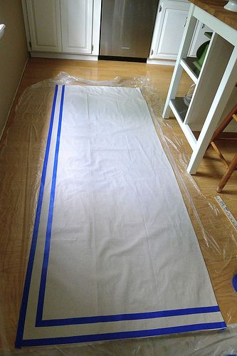 Use painters tape to add a fun trim to drop cloth curtain panels