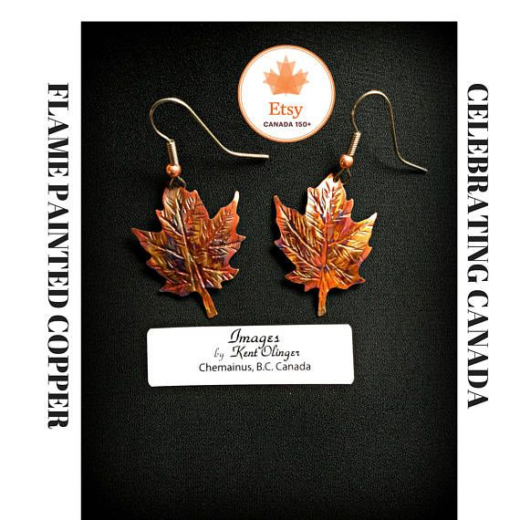 MAPLE LEAF EARRINGS TO CELEBRATE CANADA 150  Maple Leaf Earrings are hand cut and tooled from copper and then flame painted. I start with sheet copper. I use a tiny handheld jewelry saw with a pierce and cut technique, feeding the saw blade through a tiny hole pierced in the sheet copper and then cutting out the image. I then curve and shape the metal using a hammering technique. The piece is then fire torched to bring out the colors in the copper. Copper flame painting is a process whereby…