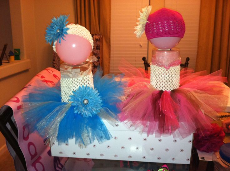 Too Cute way to display baby tutu for   craft show, etsy page or eBay, raffle, gifts.  We used a empty jerky container, flipped it upside down to hide the ugly lid and made a little ballon head!  Using this for our March for Babies fundraiser raffle.