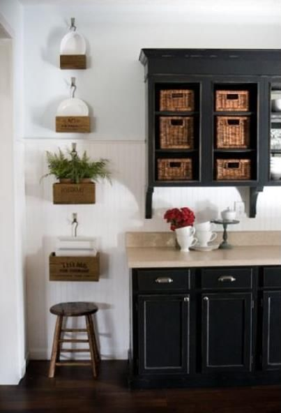Brackets under the cabinets! Definitely adds a bit of sophistication. Crown moulding helps, too.