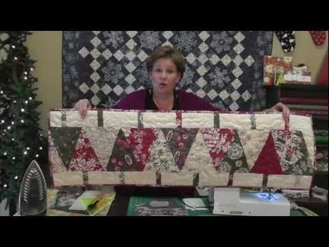 "http://missouriquiltco.com -- Jenny Doan shows how to make a cute Christmas table runner.  To get the materials needed to make this project, follow the links in the description below:     Large (10"") Simple Wedge Tool  http://www.missouriquiltco.com/shop/detail/5545    Layer Cakes (best selection of 10"" squares on the web!)  http://www.missouriquiltco..."