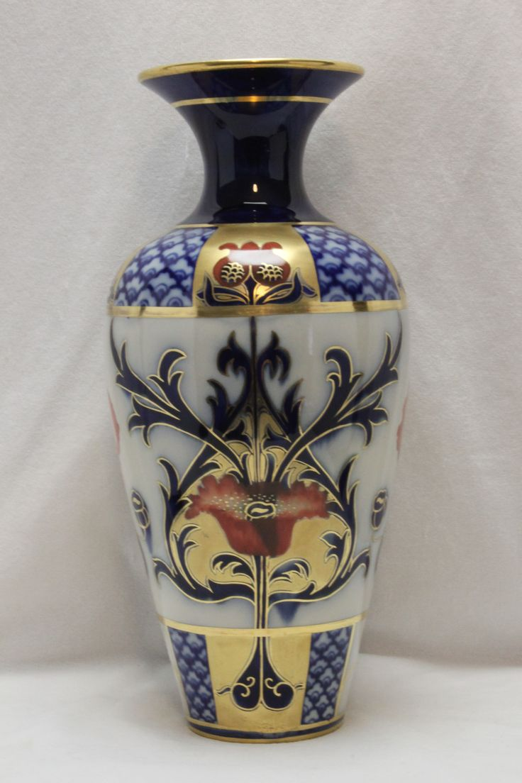 Designed by William Moorcroft in 1897 this hand coloured and gilded vase is very striking and colourful, and is in lovely condition. C 1900. www.chinaroseantiques.com.au