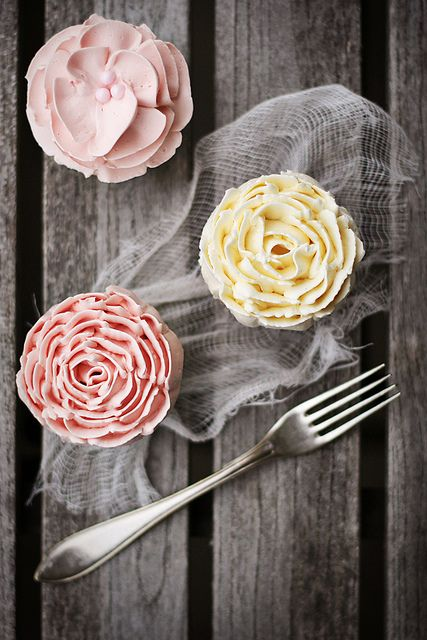 Vanilla cupcakes w/buttercream icing (recipe). Use a wilton 127 petal tip to achieve these looks. Simple!