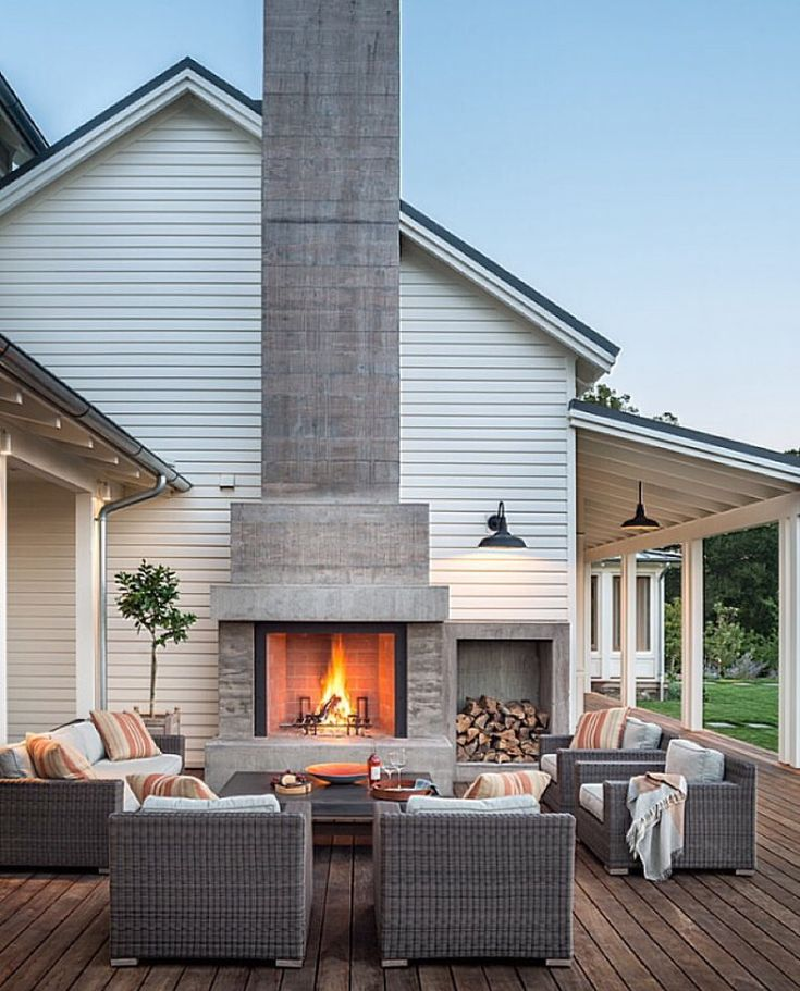 i love an outdoor fireplace w seating on a deck...