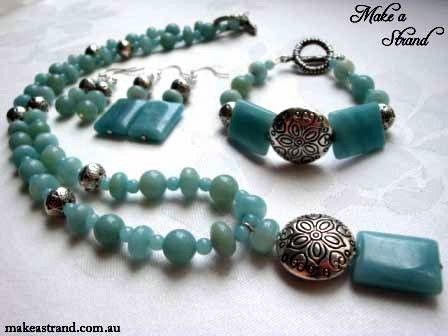 Round and rectanble blue amazonite beads are set with sterling silver ornate round focal beads in this necklace, bracelet & earrings set (sold)