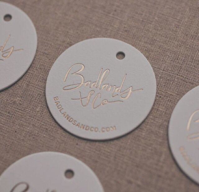 Matt golf foil-pressed swing tags for Badlands Co by Stitch Press