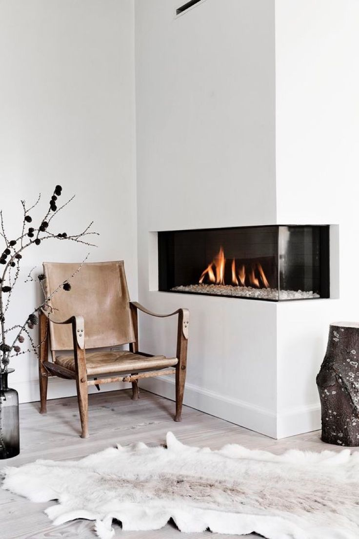 New age fireplace mixes nicely with the rustic decor