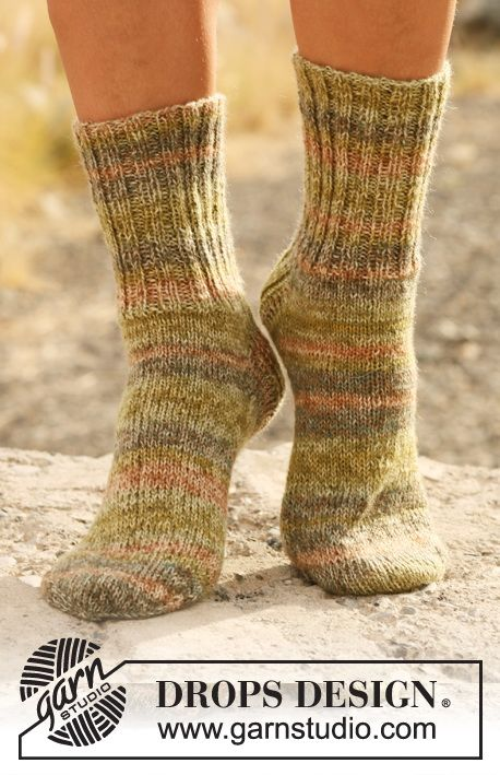 "Knitted DROPS socks with rib in ""Fabel"". All from children to men sizes."