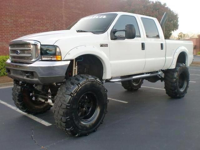 Jacked up #Ford #SuperDuty with big ol' knobby tires ...