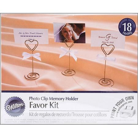 the upper portion is shaped like a heart and functions like a paperclip add a personalize card
