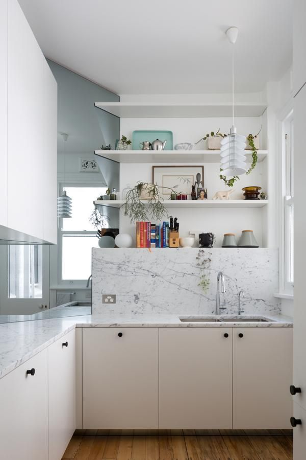 Here's an example of frameless cabinets with more traditional knobs. I also like the mix of chrome and black