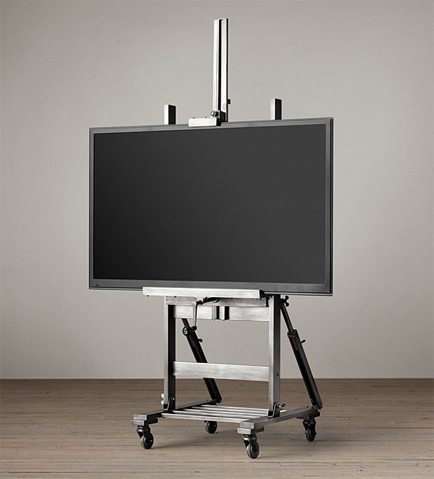 Gunmetal TV Easel - Restoration Hardware has created a TV stand modeled after the classic artist's easel. It is made of steel and wood and allows for precise height adjustment and will roll as far as your power cord is long. | Werd