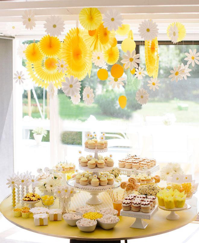 daisy themed party...love every single detail, especially the hanging decor, gumball tubes and clever arrangement of bowls in a daisy shape
