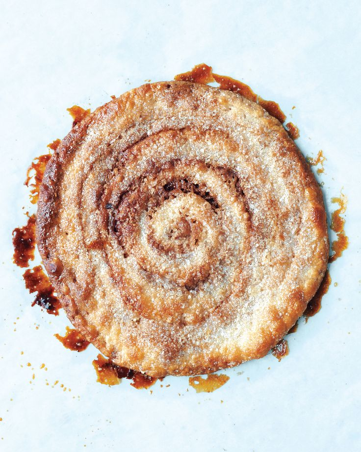 Making elephant ear cookies is easier than their coiled design might suggest. Spread the pecan-cinnamon mixture on store-bought puff pastry, and then roll, slice, flatten, and coat with sugar. They emerge from the oven crisp and caramelized.