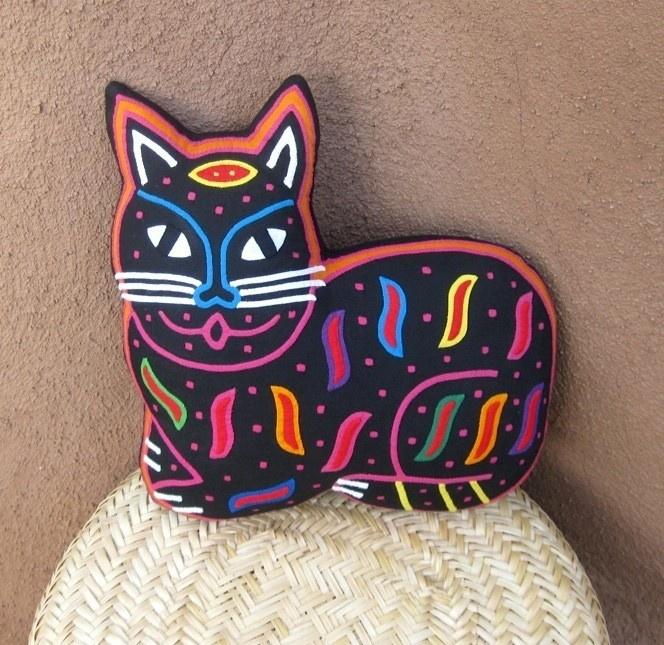 Reverse applique mola cat pillow .