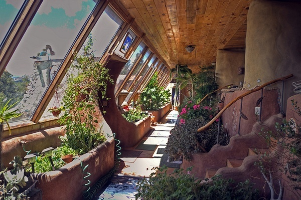 Earthship interior solarium with built in botanical cells for Garden home interiors