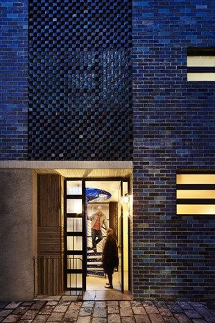 Glazed brick facade including decorative screen to upper floors | via http://www.lifestyle.com.au/property/take-a-tour-of-the-south-melbourne-brick-house.aspx