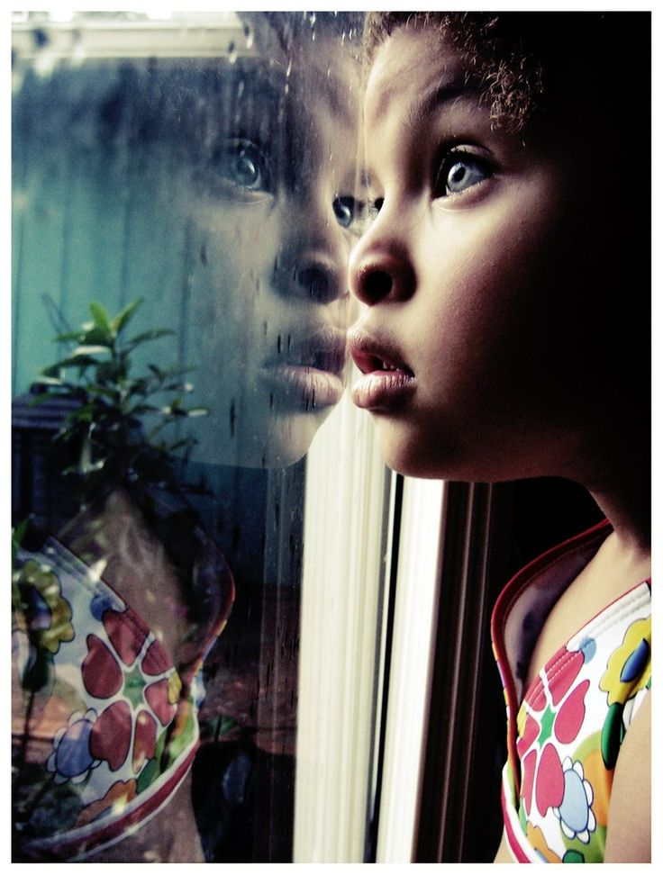 """Love the use of reflection and real rain--make the best of those """"indoor"""" days.  Good for a makeup/beauty shot...  Or cwo..?"""