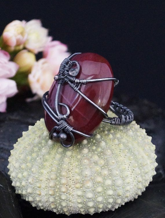 A delicate, unique, handmade, wire wrapped ring with Mokaite.  Ring was designed and made by Me, using an extremely labor-intensive and precise wire-wrapping technique, with silver 925, 930 and 999. Silver strongly oxidized and polished to emphasize the braid tangles. On a buyers request size can be adjusted by plus 1 or minus 1.  Dimensions: Jewelry Size: 13 EU ( 6,5 USA ) Inner diameter: 16,6 mm Width of ring: 3 mm  You receive this unique ring in jewelry box, so it is ready to be a gift…
