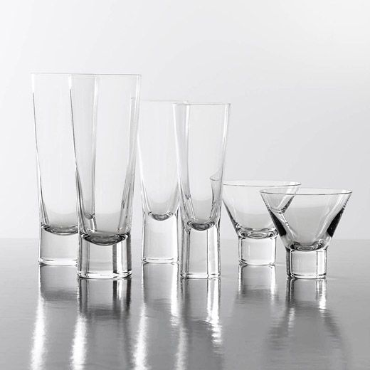 One of Iittala's most famous glass series, Goran Hongell's Aarne glasses from 1948 are beautifully weighted and a delight to drink from. Winner of the Milan Triennale in 1954 these glasses are still in production over half a century later. Sold as a pair.
