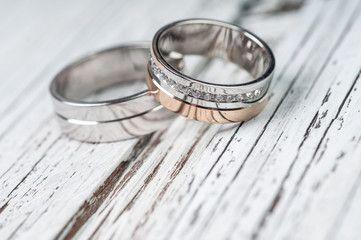 Wedding rings on rustic wood