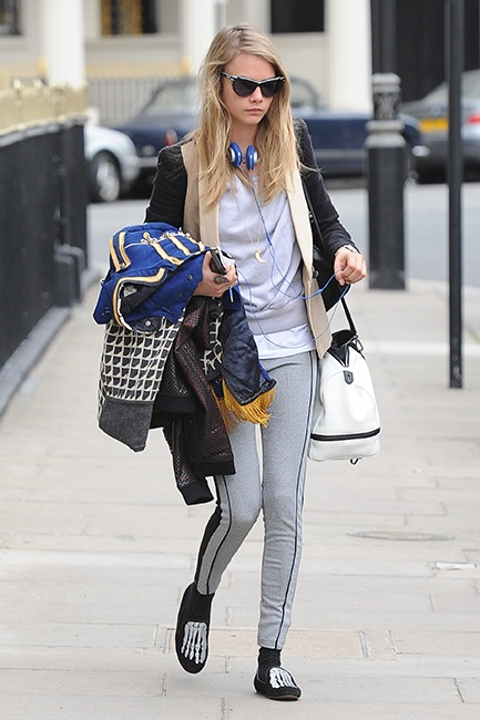 Model Cara Delvingne was spotted walking around Chelsea, England on June 12th not only carrying a blue and gold marching band jacket, but strutting the streets in a pair of Mara and Mine Jem Skull Slippers. We don't know where she's headed, but where ever she's going in those shoes, that's a party we want an invite for.