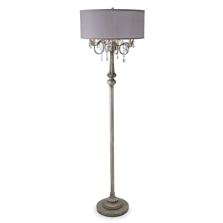 Chandi-Lumination. The Chandelier floor lamp sparkles with traditional elegance. Acrylic crystals refract the lamplight upon the silver metallic base that's decorated with an aged patina. An iridescent sheen enhances the dramatically large silver lampshade, which also features trimmed edges for another hint of elegance.