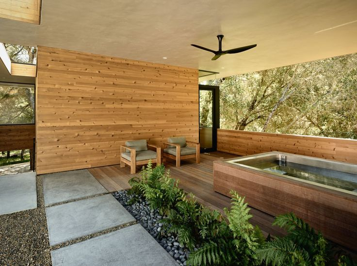 This home in California has a covered outdoor area for a spa that's located just off the guest suite.