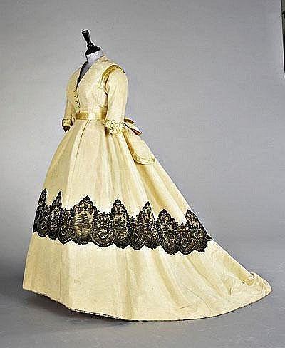 A pale yellow ottoman velvet evening gown, circa 1865