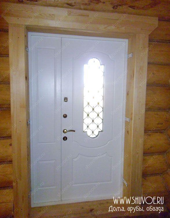 Обсада в рубленом доме: оконные и дверные проемы, установка входной двери