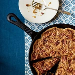 Once you've made a pecan pie in a cast-iron skillet, you may never go back to a pie plate. Simply press a refrigerated pie crust into the skillet, sprinkle with sugar, top with the pecan mixture, and bake. Serving it in the skillet is also easy and makes the dish even more Southern.