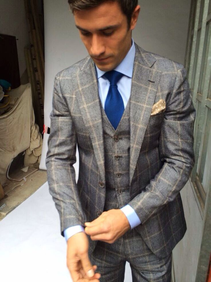 Grey check suit and blue tie and shirt